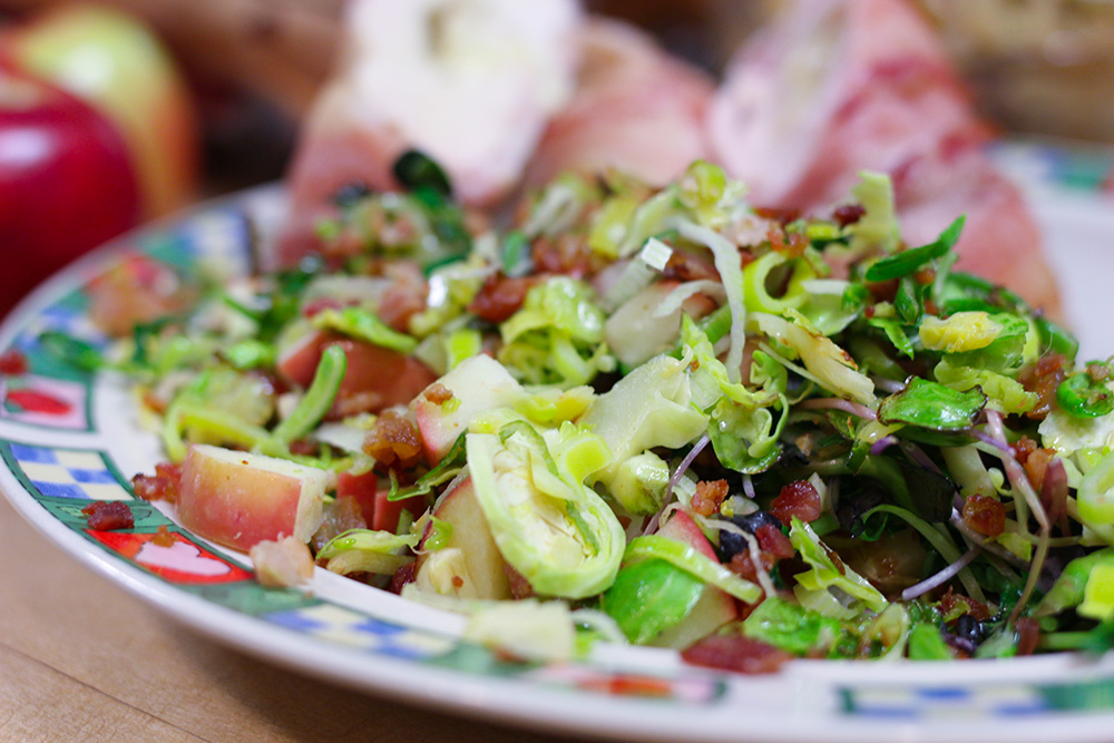 Warm Brussel Sprouts and Red Prince® Apple Salad with bacon